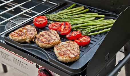 Best-Cast-Iron-Outdoor-Griddle-Camp-Chef-CGG16B-Reversible-Pre-Seasoned-Cast-Iron-Grill-Griddle-in-use